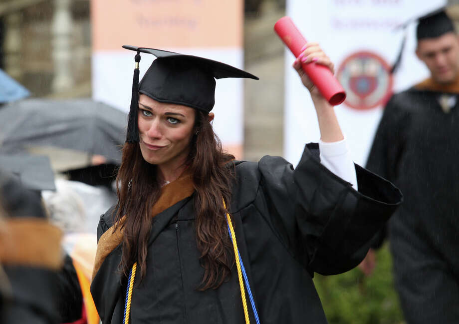 Margaret Smith, of NY, reacts after receiving her diploma during Fairfield University's 63rd Commencement ceremony on the Fairfield, Conn. campus on Sunday, May 19, 2013. Photo: BK Angeletti, B.K. Angeletti / Connecticut Post freelance B.K. Angeletti
