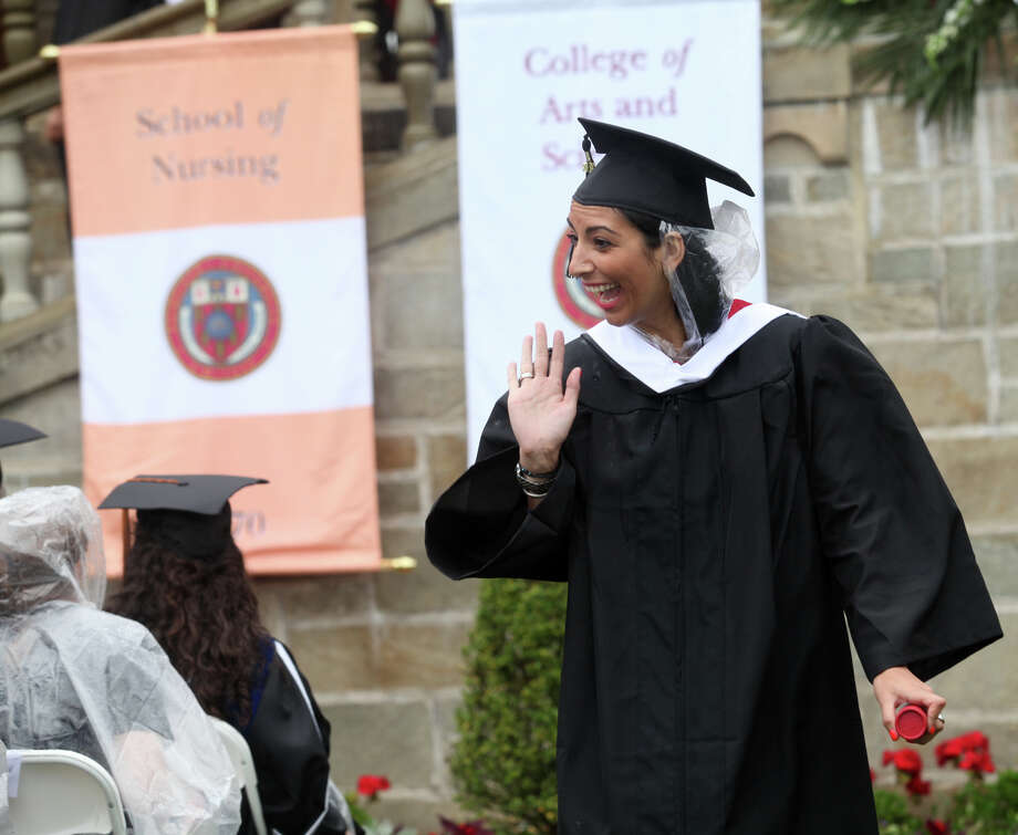 Gina Tiftikidis, of VA,  reacts after receiving her diploma during Fairfield University's 63rd Commencement ceremony on the Fairfield, Conn. campus on Sunday, May 19, 2013. Photo: BK Angeletti, B.K. Angeletti / Connecticut Post freelance B.K. Angeletti
