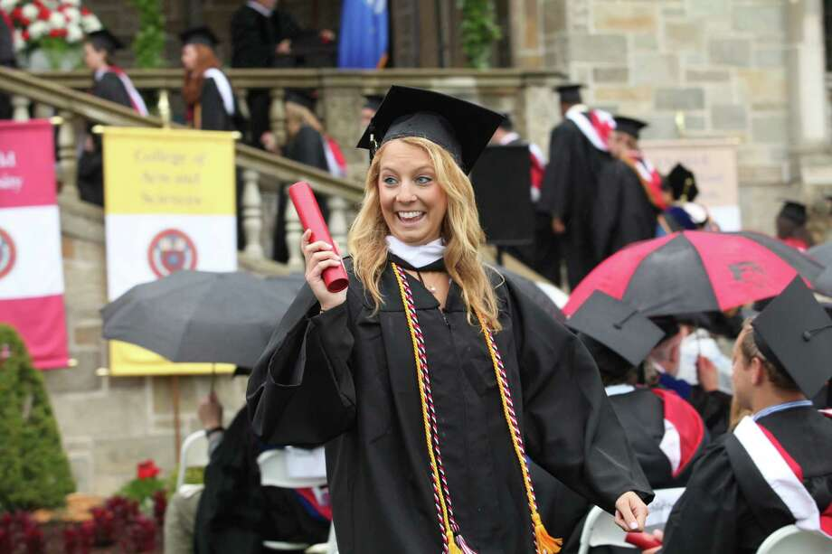 Madeline Govalski, of NY, reacts after receiving her diploma during Fairfield University's 63rd Commencement ceremony on the Fairfield, Conn. campus on Sunday, May 19, 2013. Photo: BK Angeletti, B.K. Angeletti / Connecticut Post freelance B.K. Angeletti
