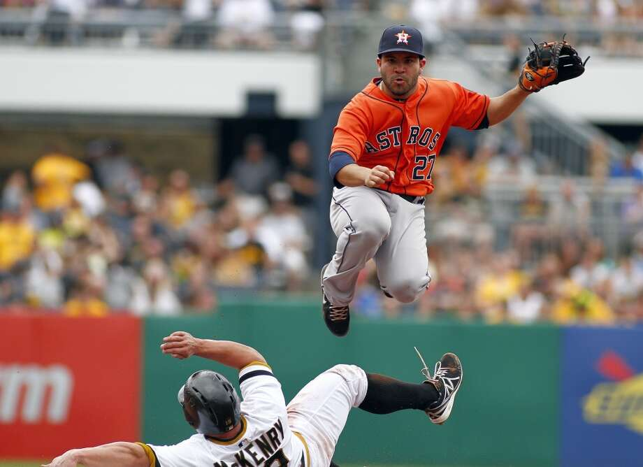 Jose Altuve of the Houston Astros attempts a double play in the fifth inning