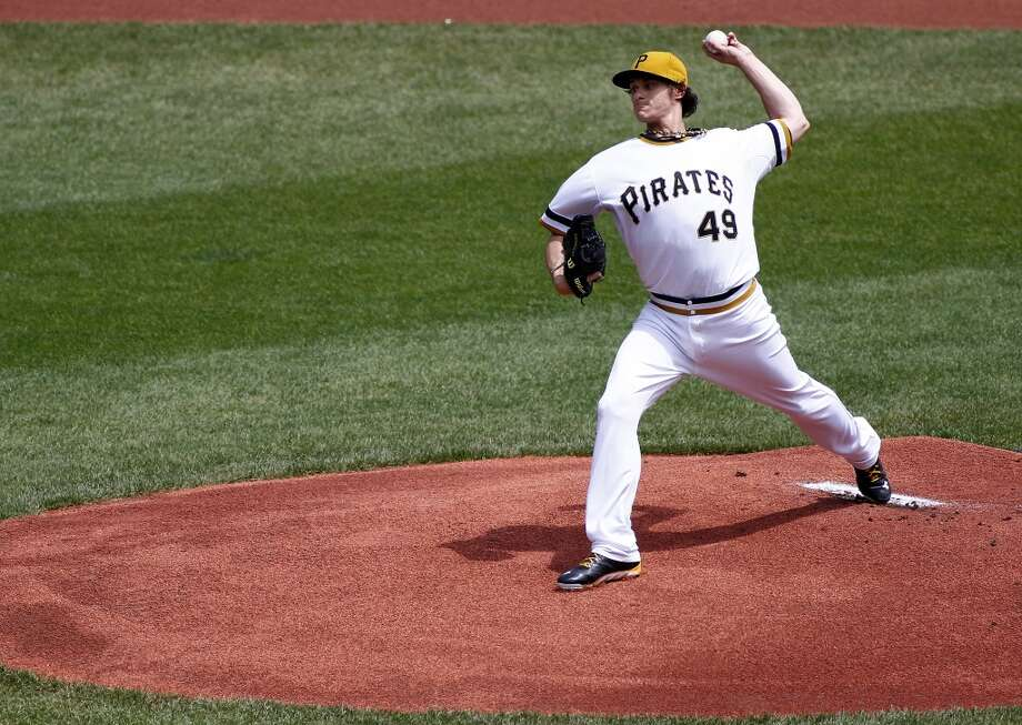Jeff Locke of the Pirates delivers a pitch to the Astros.