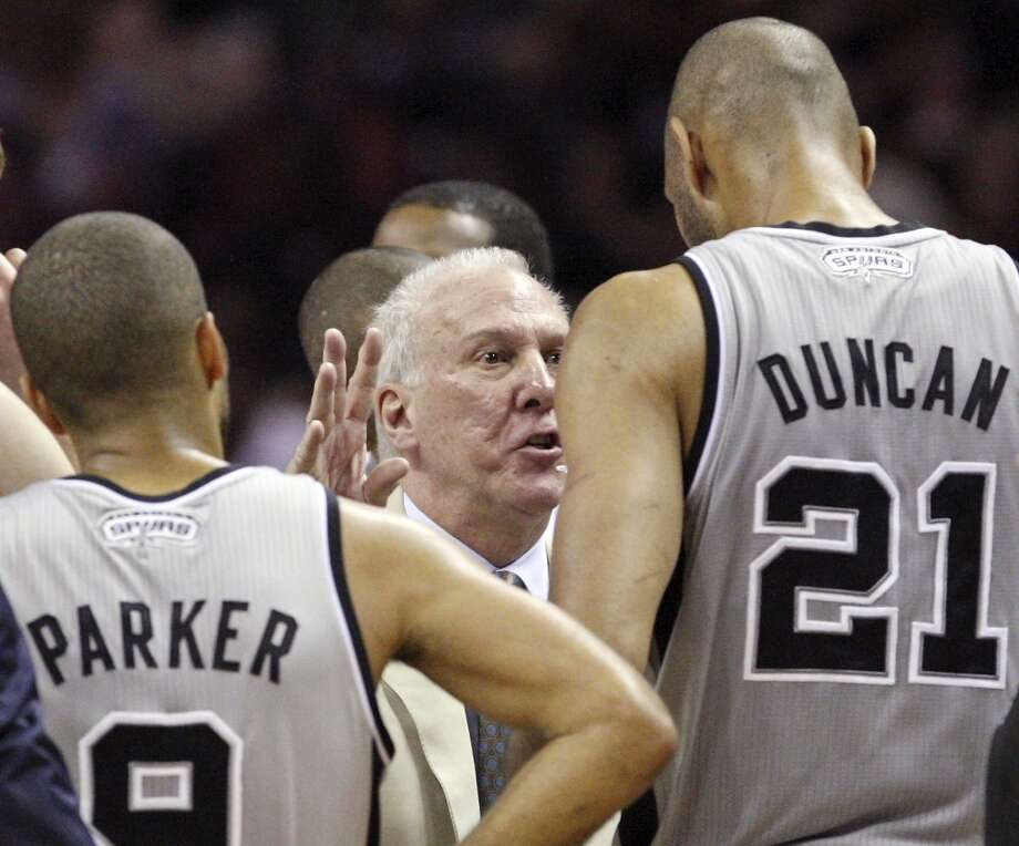 Spurs coach Gregg Popovich talks with San Antonio Spurs' Tony Parker and San Antonio Spurs' Tim Duncan during first half action of the 2013 Western Conference Finals against the Memphis Grizzlies Sunday May 19, 2013 at the AT&T Center.