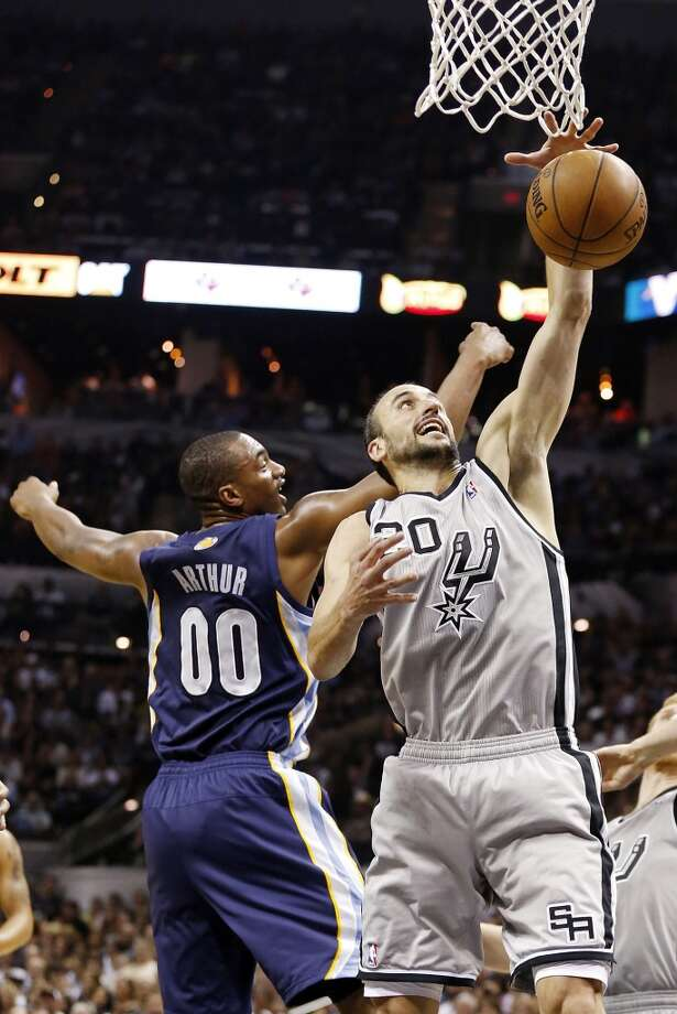The Spurs' Manu Ginobili grabs a rebound around the Grizzlies' Darrell Arthur during first half action of the 2013 Western Conference Finals Sunday May 19, 2013 at the AT&T Center.