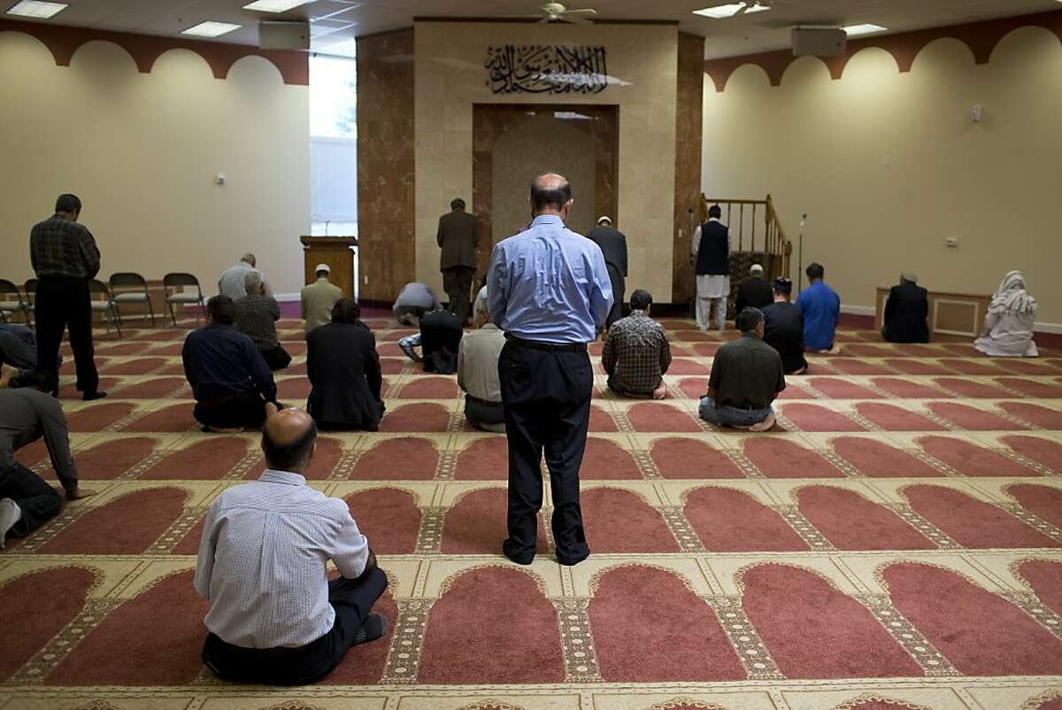 Men pray in the Ibrahim Khalilullah Islamic Center on Friday, May 17, 2013 in Fremont, Calif.