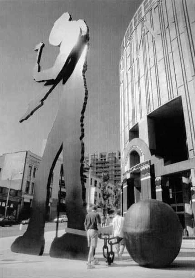 In 1993, someone attached a giant ball and chain to Hammering Man, as a shout-out to laborers. It turned out to be the work of a group led by Jason Sprinkle, Seattle's famous guerrilla performance artist in the '90s. Sprinkle died in 2005.