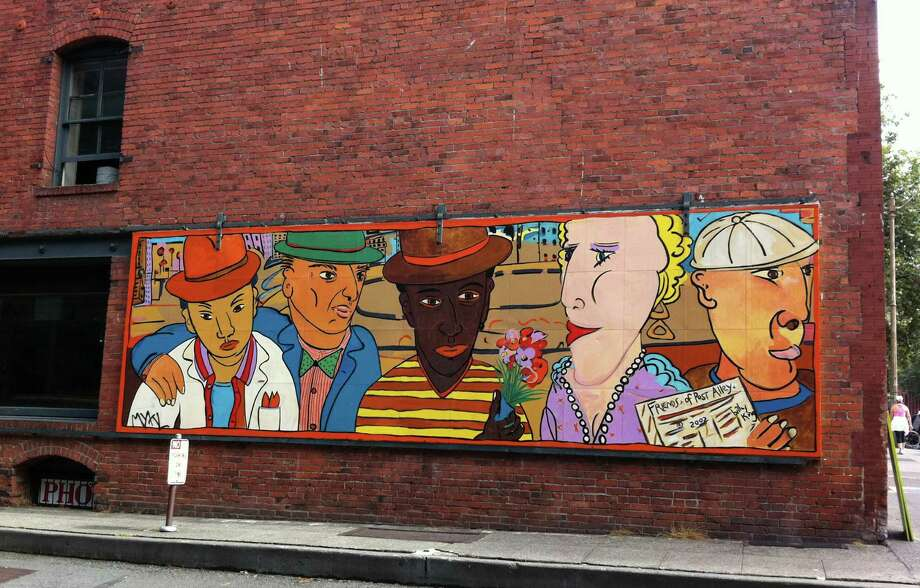 6. Billy King's mural on a bricked corner on Yesler Way and Western Ave. is a Pioneer Square landmark. (seattlepi.com photo).