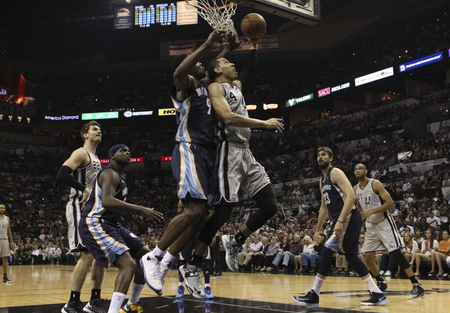 The Spurs' Danny Green (4) goes for a basket against the the Grizzlies' Tony Allen (09) in Game 1 of the first half of the 2013 Western Conference Finals at the AT&T Center on Sunday, May 19, 2013.