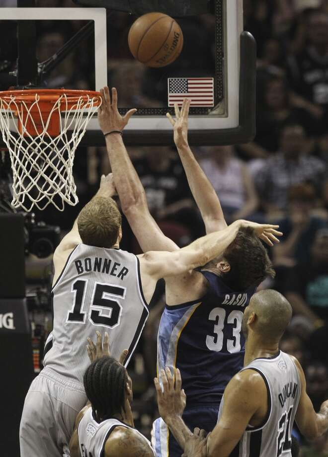 The Spurs' Matt Bonner (15) hits the head of  the Grizzlies' Marc Gasol (33) in the first half of Game 1 of the 2013 Western Conference Finals at the AT&T Center on Sunday, May 19, 2013.