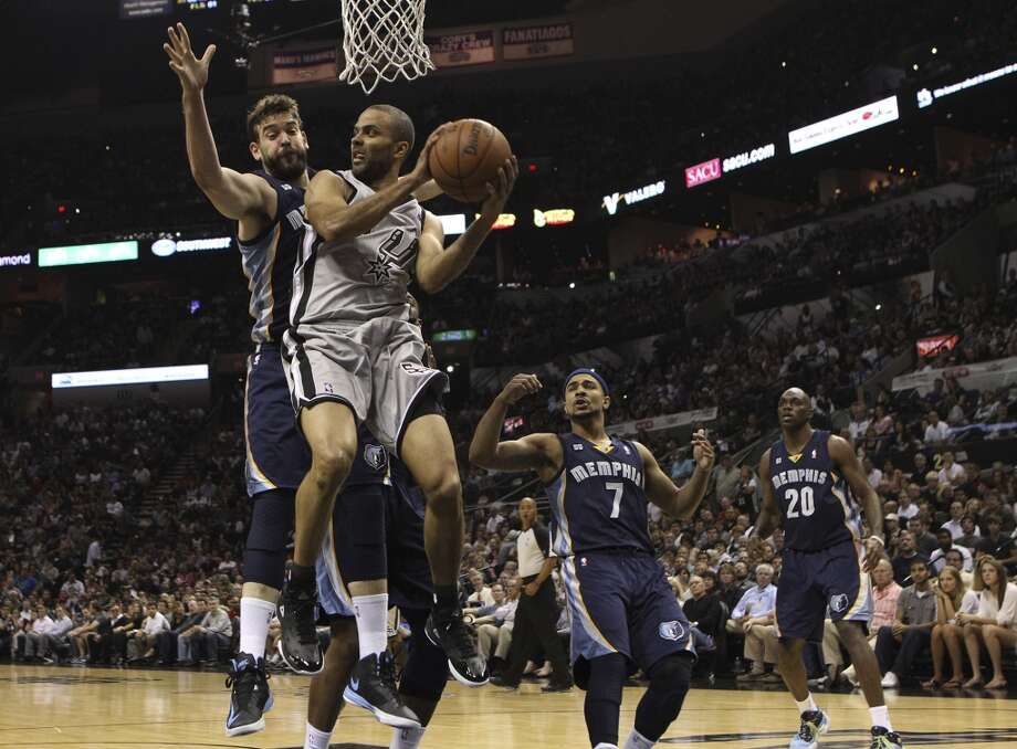 The Spurs' Tony Parker (9) looks to pass around the Grizzlies' Marc Gasol (33) in Game 1 of the first half of the 2013 Western Conference Finals at the AT&T Center on Sunday, May 19, 2013.