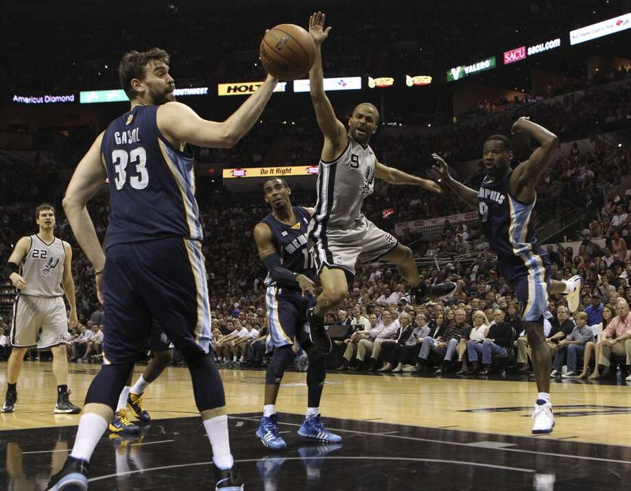 The Spurs' Tony Parker (9) loses control of the ball against the Grizzlies' Marc Gasol (33), Mike Conley (11) and Tony Allen (9) in Game 1 of the first half of the 2013 Western Conference Finals at the AT&T Center on Sunday, May 19, 2013.
