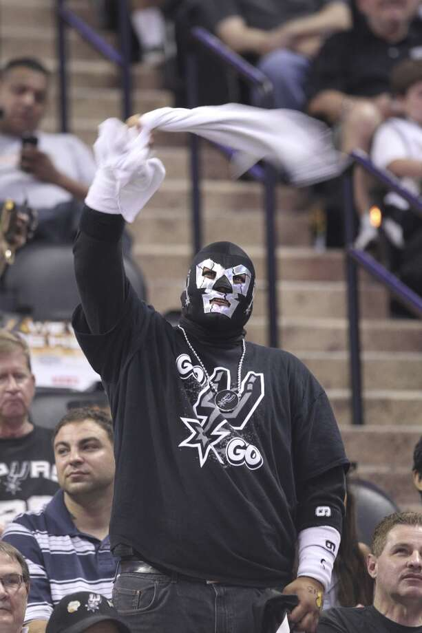 A Spurs fan waves a towel before the start of Game 1 of the Western Conference Finals between the Spurs and the Memphis Grizzlies at the AT&T Center on Sunday, May 19, 2013.