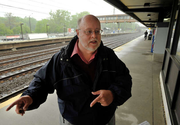 Jim Cameron talks to a reporter at the Noroton Heights train station in Darien on Sunday, May 19, 2013. Cameron is the chairman of the Connecticut Rail Commuter Council. Photo: Jason Rearick / Stamford Advocate
