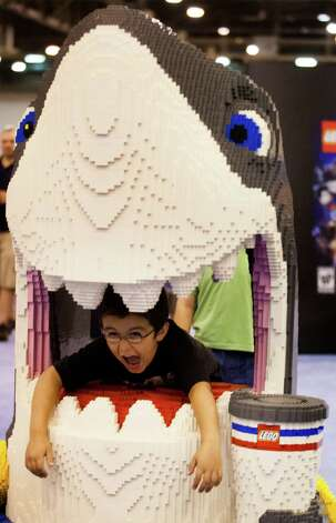 Landon Hittle, 6, plays in the mouth of a LEGO shark during LEGO KidsFest national tour at Reliant Park on Sunday, May 19, 2013, in Houston. The three day event had three acres of hands-on educational fun for all ages including life-sized models made entirely from LEGO bricks, construction zones for creative free build, and game arenas Photo: J. Patric Schneider, For The Chronicle / © 2013 Houston Chronicle