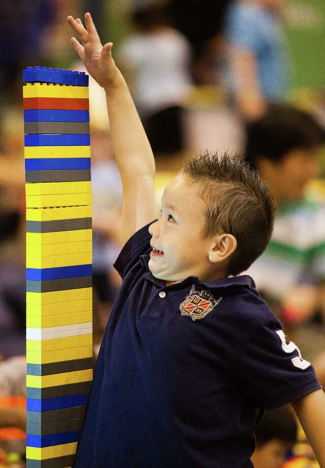 Mateo Negrete ,4, measures the size of his lego creation during Lego KidsFest national tour at Reliant Park on Sunday, May 19, 2013, in Houston. The three day event had three acres of hands-on educational fun for all ages including life-sized models made entirely from Lego bricks, construction zones for creative free build, and game arenas Photo: J. Patric Schneider, For The Chronicle / © 2013 Houston Chronicle