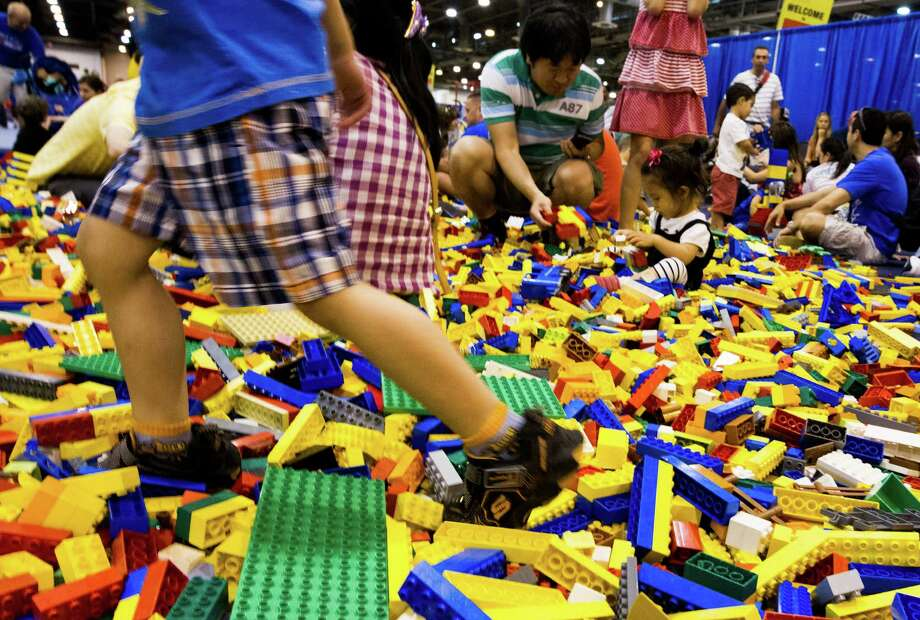 Kids play in the creative free play area during the Lego KidsFest national tour at Reliant Park on Sunday, May 19, 2013, in Houston. The three day event had three acres of hands-on educational fun for all ages including life-sized models made entirely from Lego bricks, construction zones for creative free build, and game arenas Photo: J. Patric Schneider, For The Chronicle / © 2013 Houston Chronicle