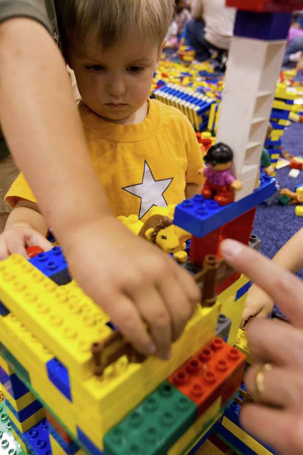Jake Riley, 3, works on his building while playing in the creative free play area during the Lego KidsFest national tour at Reliant Park on Sunday, May 19, 2013, in Houston. The three day event had three acres of hands-on educational fun for all ages including life-sized models made entirely from Lego bricks, construction zones for creative free build, and game arenas Photo: J. Patric Schneider, For The Chronicle / © 2013 Houston Chronicle
