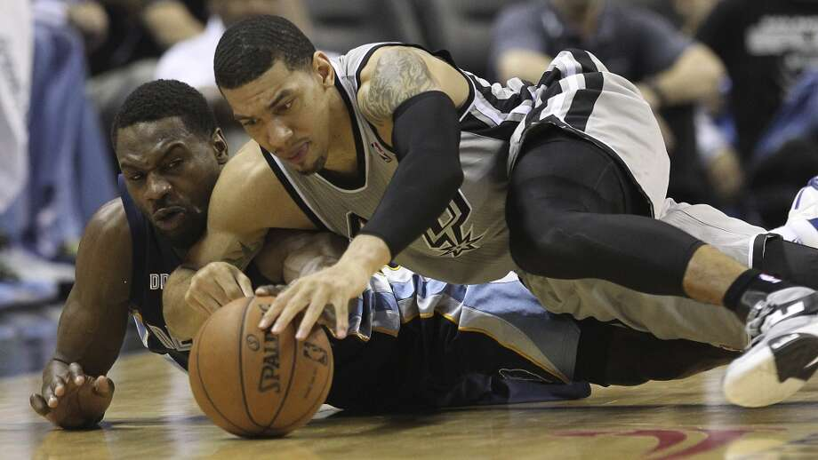 The Spurs' Danny Green (4) and Grizzlies' Tony Allen (9) collide for a loose ball in the second half of Game 1 of the 2013 Western Conference Finals at the AT&T Center on Sunday, May 19, 2013. Spurs won 105-83.