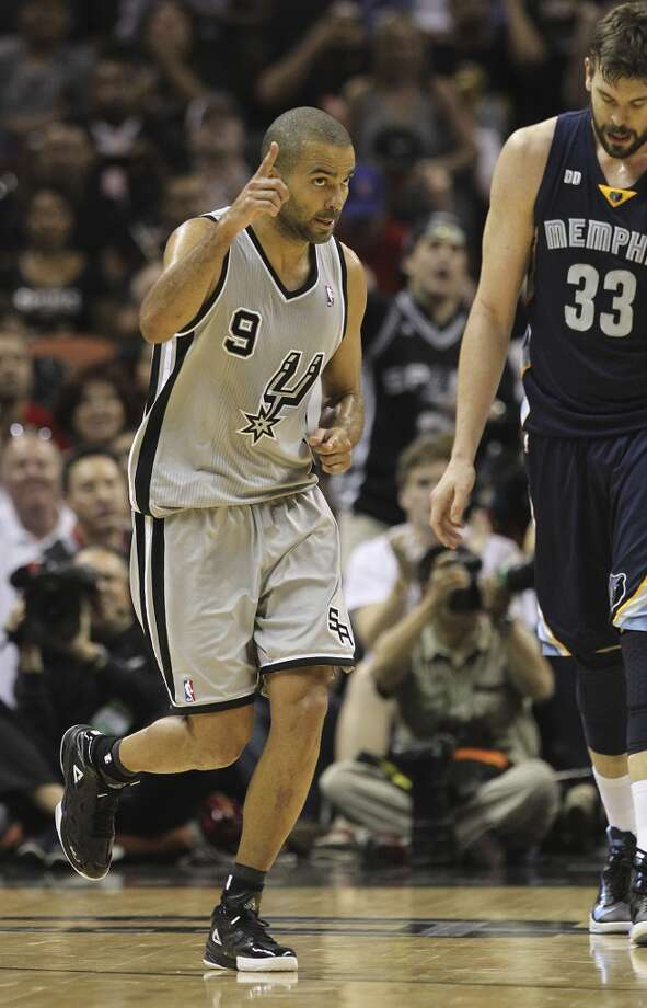 The Spurs' Tony Parker (9) gestures after scoring against the Grizzlies' Marc Gasol (33) in the second half of Game 1 of the 2013 Western Conference Finals at the AT&T Center on Sunday, May 19, 2013. Spurs won 105-83.