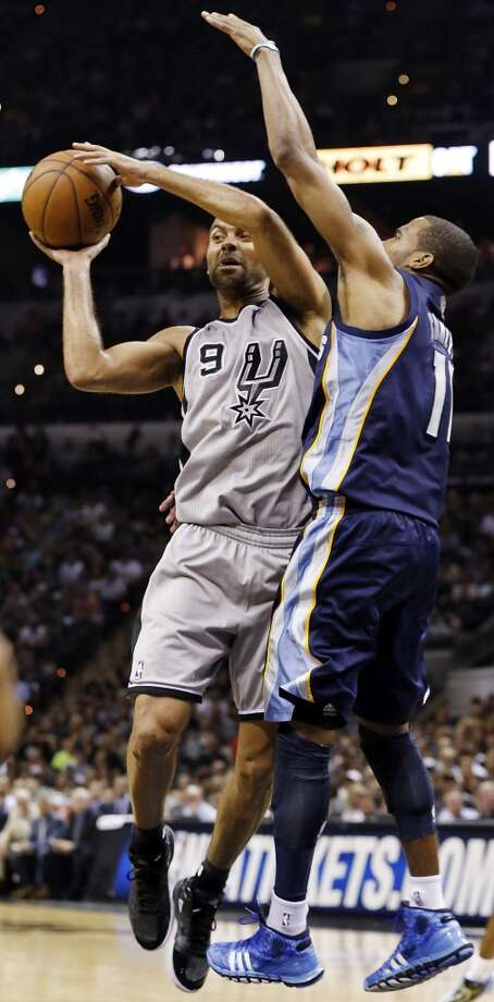 The Spurs' Tony Parker looks to pass around the Grizzlies' Mike Conley during second half action of the 2013 Western Conference Finals Sunday May 19, 2013 at the AT&T Center. The Spurs won 105-83.