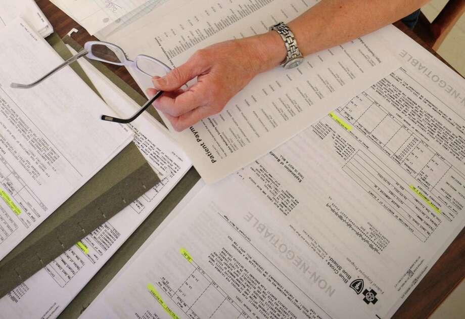 VantageScore Solutions has decided to ignore collection actions on credit reports — more than half of which are typically tied to medical debts — as long as the collections are paid. Photo: Associated Press File Photo