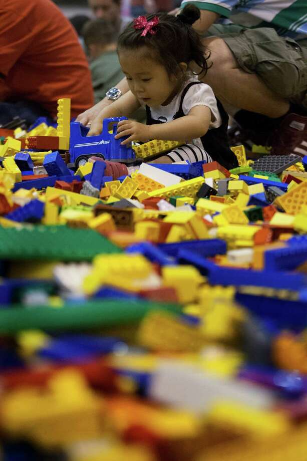 Rino Hisata, 2, plays in the creative free play area during the Lego KidsFest national tour at Reliant Park on Sunday, May 19, 2013, in Houston. The three day event had three acres of hands-on educational fun for all ages including life-sized models made entirely from Lego bricks, construction zones for creative free build, and game arenas Photo: J. Patric Schneider, For The Chronicle / © 2013 Houston Chronicle