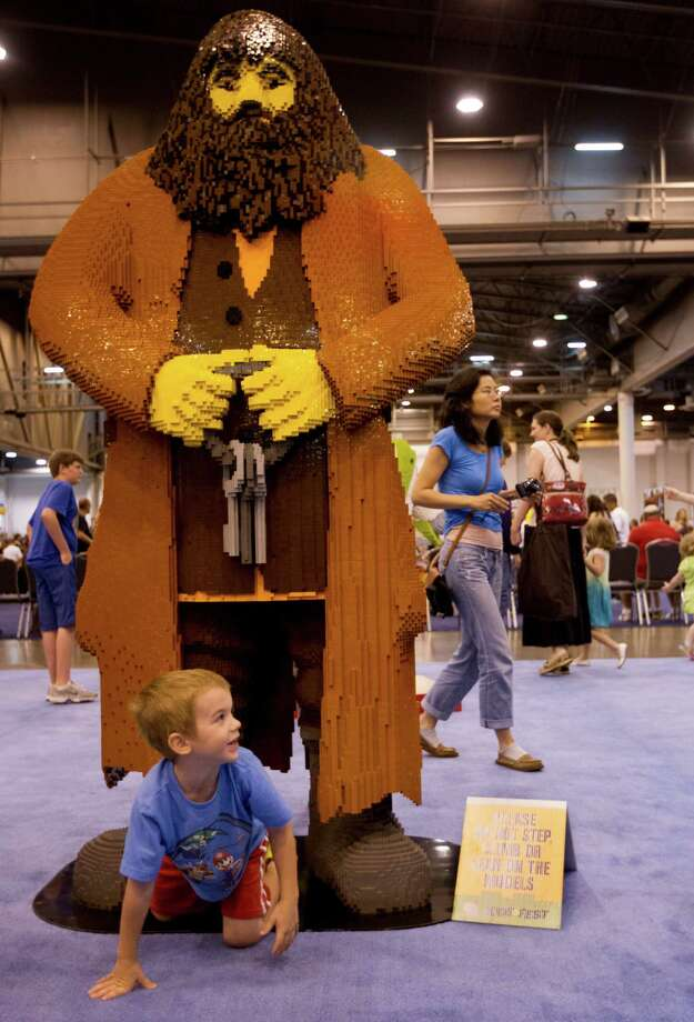 Grant Wylie, 6, crawls under a life size lego Hagrid from the Harry Potter movies during the Lego KidsFest national tour at Reliant Park on Sunday, May 19, 2013, in Houston. The three day event had three acres of hands-on educational fun for all ages including life-sized models made entirely from Lego bricks, construction zones for creative free build, and game arenas Photo: J. Patric Schneider, For The Chronicle / © 2013 Houston Chronicle