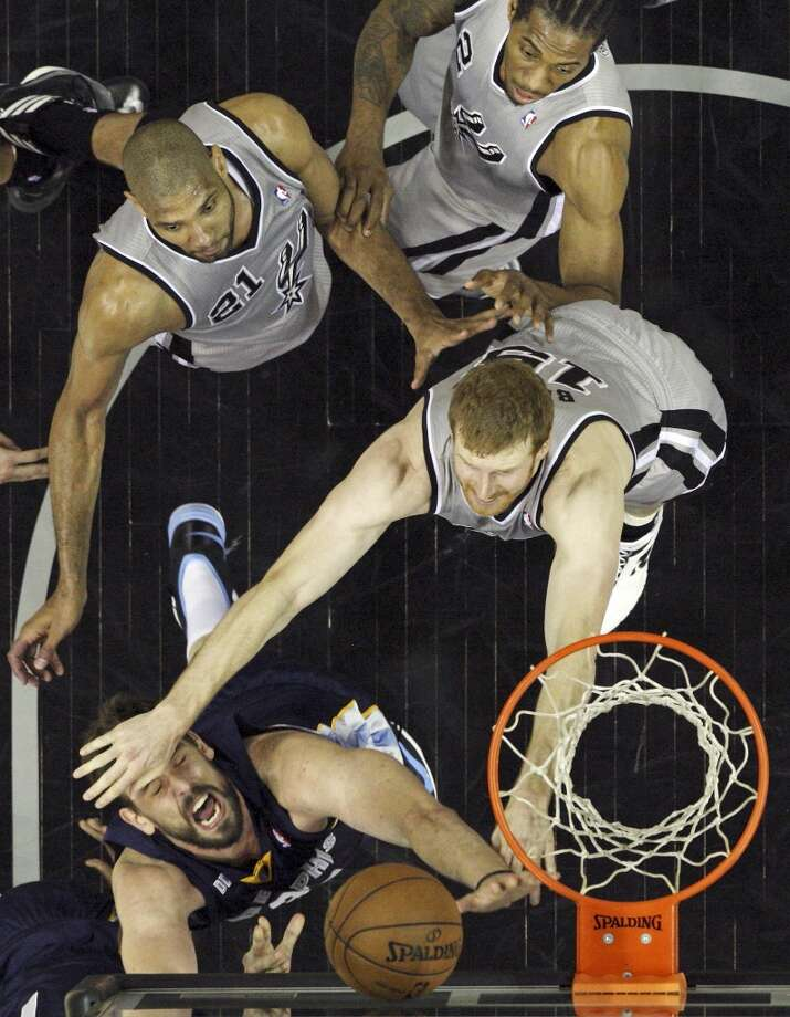 The Grizzlies' Marc Gasol shoots around the Spurs' Matt Bonner as Tim Duncan and Kawhi Leonard look on during first half action of the 2013 Western Conference Finals Sunday May 19, 2013 at the AT&T Center. The Spurs won 105-83.