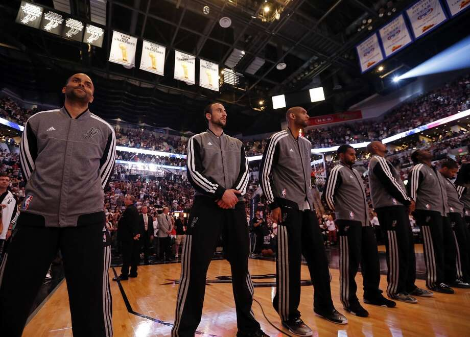 Members of the Spurs stand during the national anthem before the 2013 Western Conference Finals against the Memphis Grizzlies Sunday May 19, 2013 at the AT&T Center.
