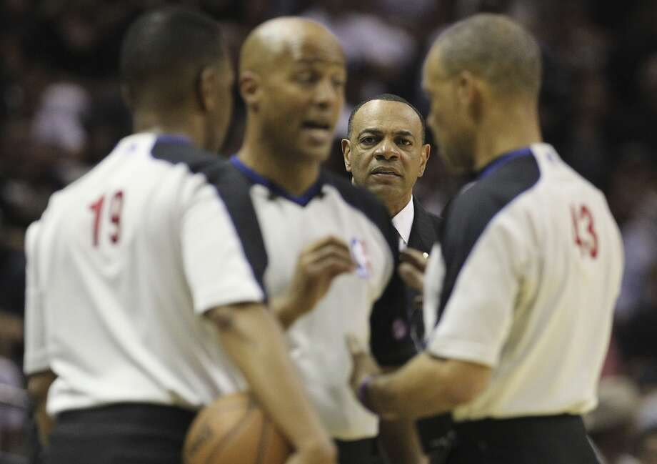 Grizzlies coach Lionel Hollins awaits a call between game officials in the first half of Game 1 of  the 2013 Western Conference Finals at the AT&T Center on Sunday, May 19, 2013.