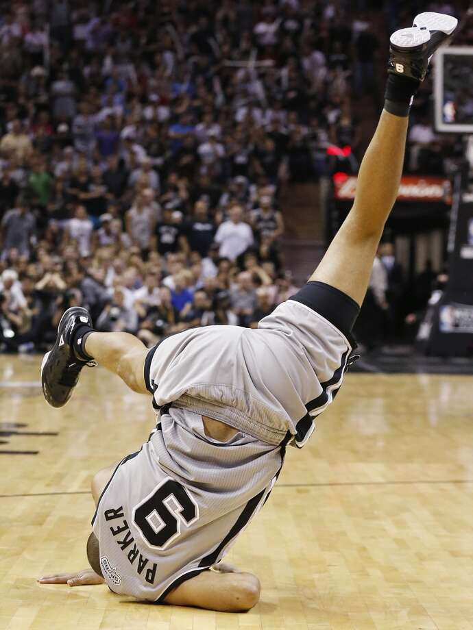 The Spurs' Tony Parker flips over after a play during second half action of the 2013 Western Conference Finals against the Grizzlies on Sunday May 19, 2013 at the AT&T Center. The Spurs won 105-83.
