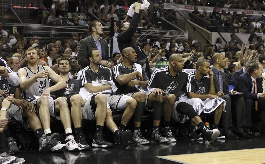 The Spurs bench reacts to the reserve players on the floor in the closing moments of Game 1 of the Western Conference Finals against the Memphis Grizzlies at the AT&T Center on Sunday, May 19, 2013. Spurs won 105-83.