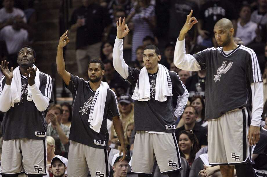 The Spurs' DeJuan Blair (from left), Patty Mills, Danny Green and Tim Duncan react after Manu Ginobili was fouled during first half action of the 2013 Western Conference Finals against the Grizzlies Sunday May 19, 2013 at the AT&T Center. San Antonio Spurs' Manu Ginobili shot three free throws.