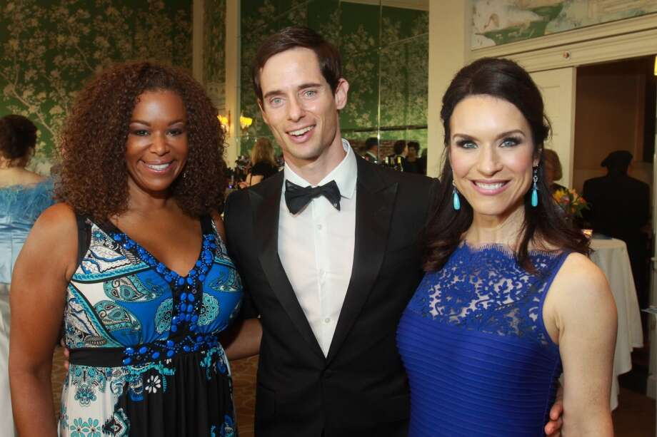 Emcee Deborah Duncan, left, with gala chairs Henry Richardson and Samantha Kennedy.