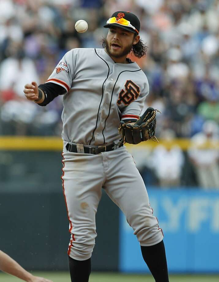 San Francisco Giants shortstop Brandon Crawford bobbles ball after forcing out Colorado Rockies runner at second base in the fifth inning of a baseball game in Denver on Sunday, May 19, 2013. (AP Photo/David Zalubowski) Photo: David Zalubowski, Associated Press