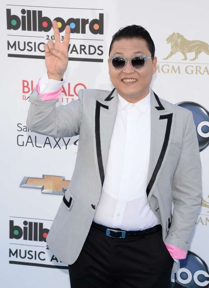 South Korean rapper Psy arrives on the red carpet for the 2013 Billboard Music Awards at the MGM Grand in Las Vegas, Nevada, May 19, 2013.   AFP PHOTO / ROBYN BECKROBYN BECK/AFP/Getty Images