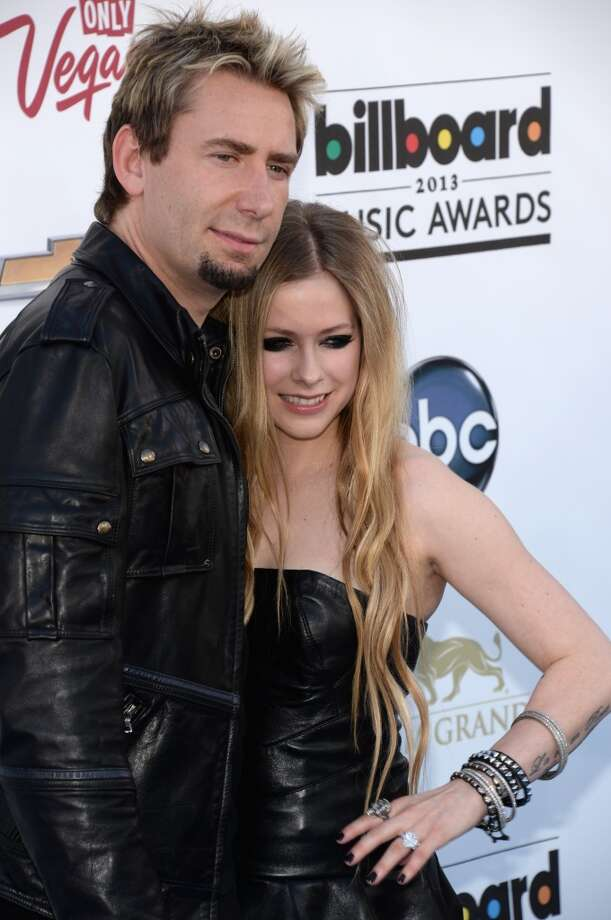 April Lavigne and Chad Kroeger arrive on the red carpet at the 2013 Billboard Music Awards at the MGM Grand in Las Vegas, Nevada, May 19, 2013.   AFP PHOTO / ROBYN BECKROBYN BECK/AFP/Getty Images