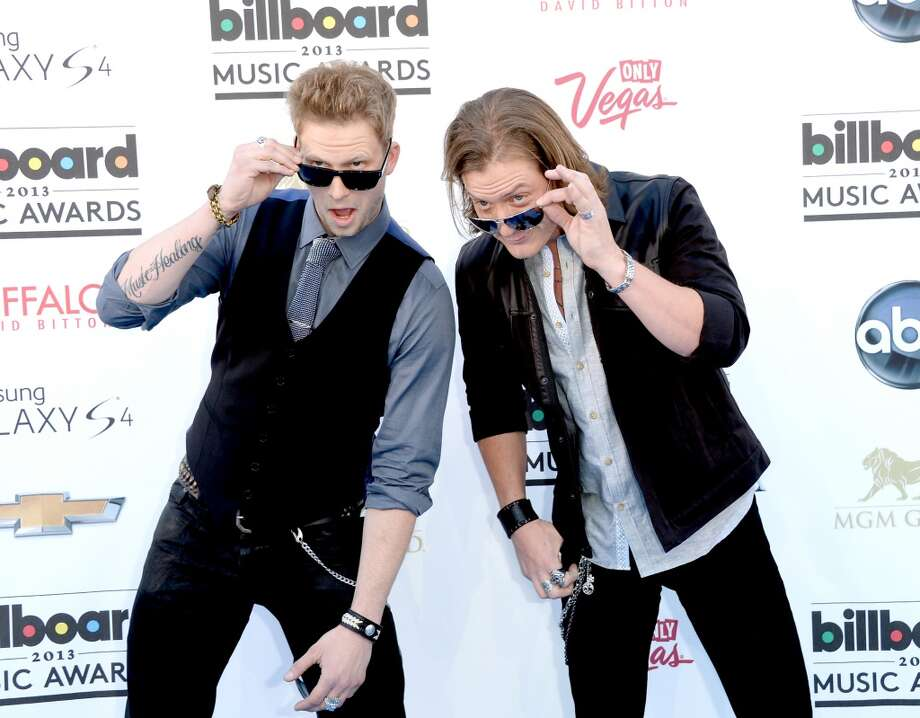 LAS VEGAS, NV - MAY 19:  Singers Brian Kelley (L) and Tyler Bubbard of Florida Georgia Line arrive at the 2013 Billboard Music Awards at the MGM Grand Garden Arena on May 19, 2013 in Las Vegas, Nevada.  (Photo by Jason Merritt/Getty Images)