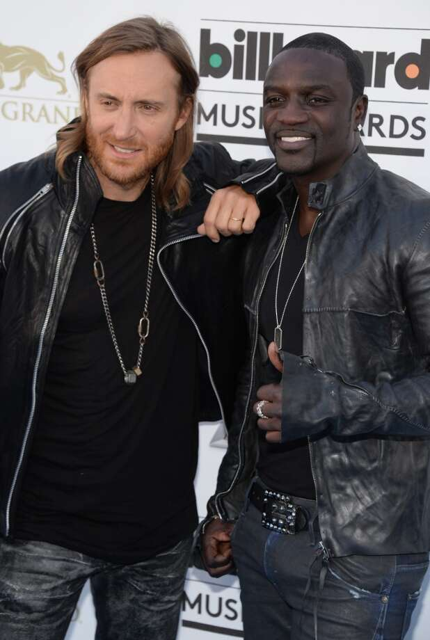 David Guetta and Akon arrive on the red carpet at the 2013 Billboard Music Awards at the MGM Grand in Las Vegas, Nevada, May 19, 2013.   AFP PHOTO / ROBYN BECKROBYN BECK/AFP/Getty Images
