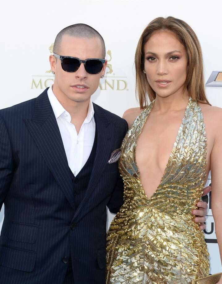 Casper Smart and singer Jennifer Lopez arrives at the 2013 Billboard Music Awards at the MGM Grand Garden Arena on May 19, 2013 in Las Vegas, Nevada.  (Photo by Jason Merritt/Getty Images)