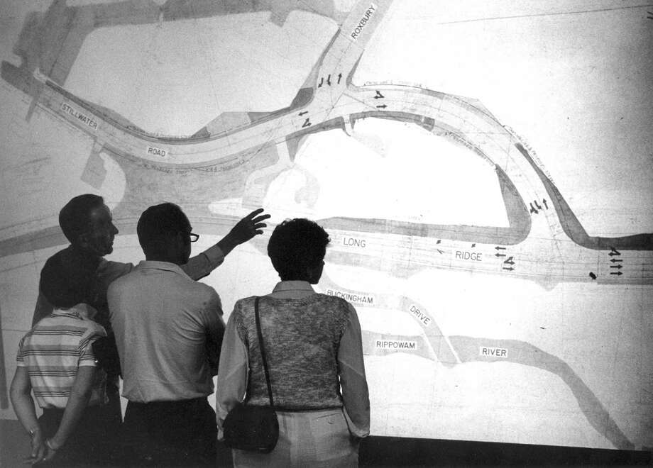 City Rep. Thomas Burke points out landmarks on a projected map showing plans for traffic flow problems at Long Ridge, Roxbury and Stillwater roads. Photo: File