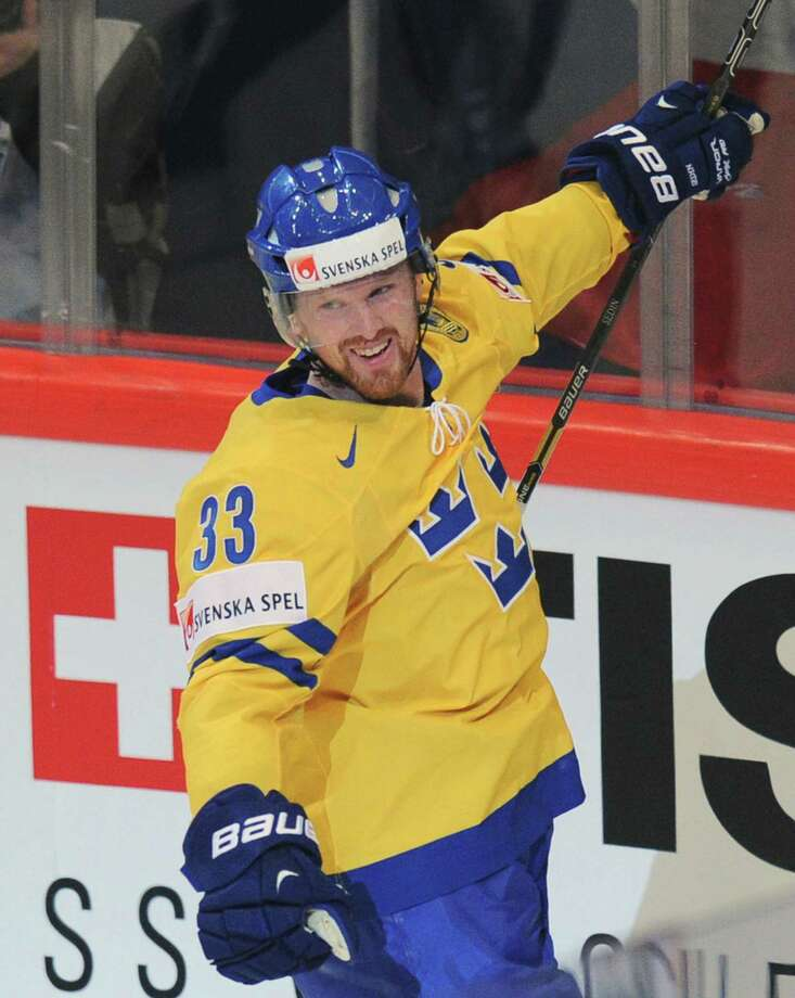 Sweden's forward Henrik Sedin celebrates scoring during the final match Switzerland vs Sweden of the 2013 IIHF International Ice Hockey World Championship in Stockholm on May 19, 2013.   AFP PHOTO/ ALEXANDER NEMENOV          RESTRICTED TO EDITORIAL USEALEXANDER NEMENOV/AFP/Getty Images Photo: ALEXANDER NEMENOV