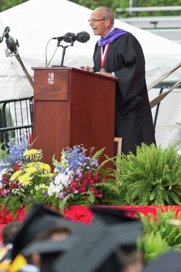 Sacred Heart University Michael Giarratano reads a citation during SHU commencement exercises in Fairfeild, Conn. on Sunday May 19, 2013. Photo: Mike Ross / Connecticut Post contributed