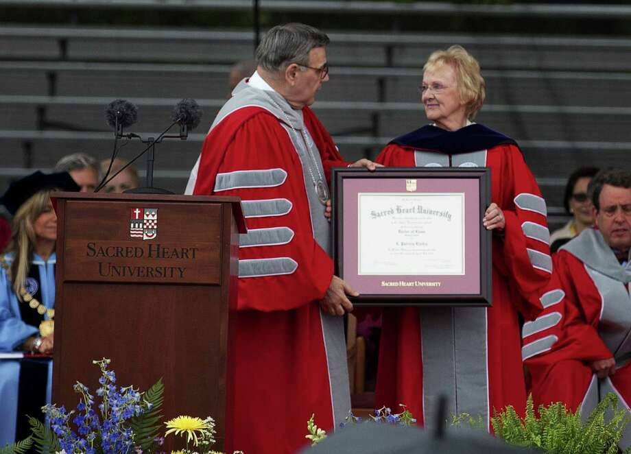 Sacred Heart University President Dr. John J. Petillo gives honorary degree to Newtown First Selectman E. Patricia at the 2013 graduation ceremony in Fairfield, Conn. on Sunday May 19, 2013. Photo: Mike Ross / Connecticut Post contributed