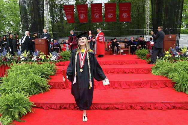 Sacred Heart University's graduate Amanad Rea of Stratford makes her way down the stage after receiving her diploma at the commencement ceremony on Sunday May 19, 2013 in Fairfield, Conn. Photo: Mike Ross / Connecticut Post contributed