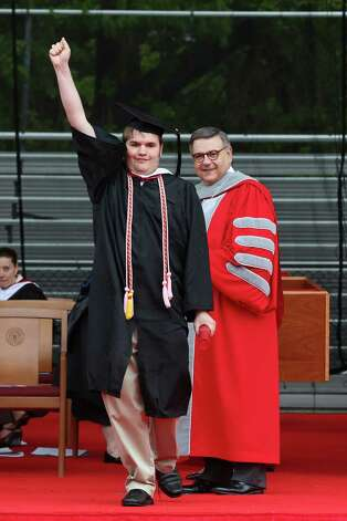Sacred Heart University's graduate Nathaniel Milbank celebrates after receving his diploma  during SHU commencement exercises on Sunday May 19, 2013. Photo: Mike Ross / Connecticut Post contributed
