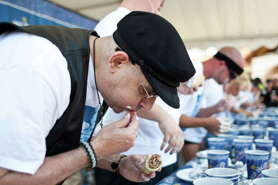 Alex Brouskakis, of Houston, tries to compete in the Sixth Annual Niko Niko's World Eating Championship during Houston Greekfest 2013, Sunday, May 19, 2013, at St. Basil's the Great Greek Orthodox Church in Houston.Brouskakis said he started to choke half way through the first gyro and thought they were going to have to carry him out. Brouskakis ate three and a half of the half pound gyros.  A new world record was set by Joey Chestnut eating 22 and a half half pound gyros with all the fixings. Photo: Nick De La Torre, Chronicle / © 2013 Houston Chronicle