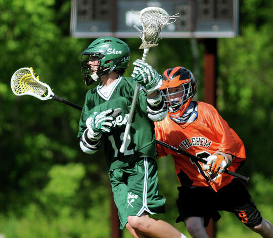 Shen's Adam Barcon, left, carries the ball as Bethlehem's Connor Owens defends during their freshman lacrosse game against Bethlehem on Friday, May 17, 2013, at Bethlehem High in Delmar, N.Y. (Cindy Schultz / Times Union) Photo: Cindy Schultz / 10022453A