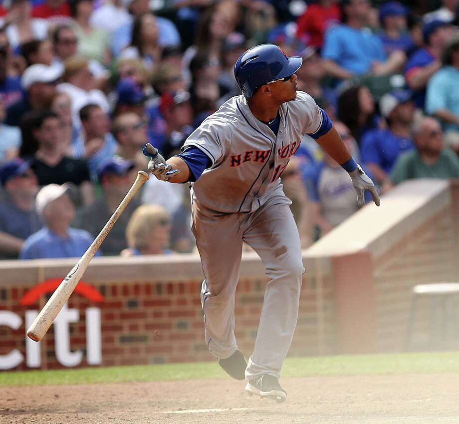New York Mets' Juan Lagares hits a two-run home run seventh inning to give the Mets a 3-3 tie with the Chicago Cubs in a baseball game in Chicago on Sunday, May 19, 2013. (AP Photo/Charles Cherney) Photo: Charles Cherney
