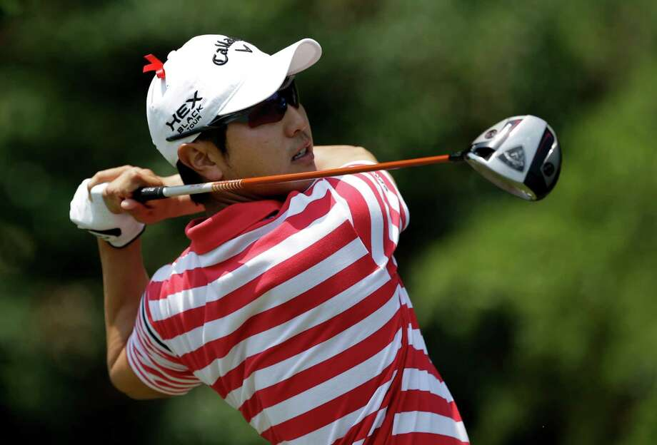 Sang-Moon Bae, of South Korea, hits off the first tee during the final round of the Byron Nelson golf tournament Sunday, May 19, 2013, in Irving, Texas. Bae and the rest of the field are wearing a red ribbon in memory of former US Open champion and long time analyst Ken Venturi. (AP Photo/Tony Gutierrez) Photo: Tony Gutierrez