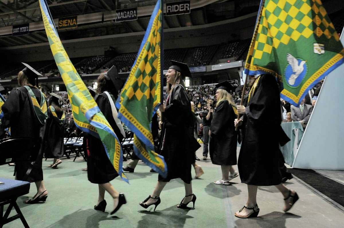 Graduates in the Alpha Kappa Alpha Honor Society process in during the college commencement ceremony for Siena College at the Times Union Center on Sunday, May 19, 2013 in Albany, NY. (Paul Buckowski / Times Union)